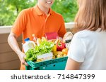 grocery store delivery man... | Shutterstock . vector #714847399