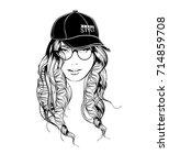 a girl in a baseball cap and... | Shutterstock .eps vector #714859708