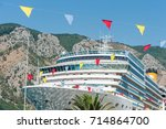 big liner in port on mountains... | Shutterstock . vector #714864700