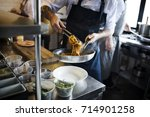 chef cooking spaghetti in the... | Shutterstock . vector #714901258