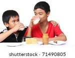young asian boys drinking milk - stock photo