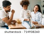 proud parents watching their... | Shutterstock . vector #714938260