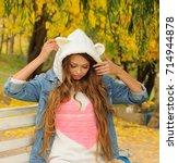 pretty girl in a knitted bear... | Shutterstock . vector #714944878