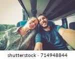 backpackers traveling around... | Shutterstock . vector #714948844