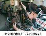 elegant attractive woman worker ... | Shutterstock . vector #714958114