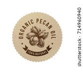organic pecan oil emblem with... | Shutterstock .eps vector #714960940