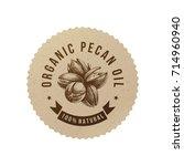 organic pecan oil emblem with... | Shutterstock .eps vector #714960940