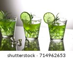 three green cocktails with lime ... | Shutterstock . vector #714962653