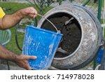 a worker woman handling a... | Shutterstock . vector #714978028