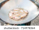 the cooking process  fry the... | Shutterstock . vector #714978364