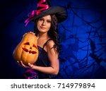halloween pumpkin in witch...