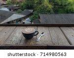 a cup of hot latte art coffee... | Shutterstock . vector #714980563