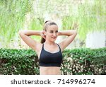 fit and sporty girl doing... | Shutterstock . vector #714996274