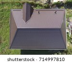 the roof of corrugated sheet.... | Shutterstock . vector #714997810