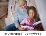 grandmother teach granddaughter ... | Shutterstock . vector #714999958