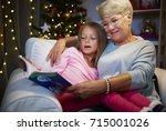 grandmother and grandaughter in ... | Shutterstock . vector #715001026