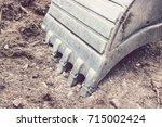 excavator bucket with copy... | Shutterstock . vector #715002424