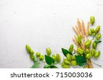 wheat and hops on a wooden... | Shutterstock . vector #715003036