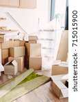 cardboard boxes and rolled... | Shutterstock . vector #715015900