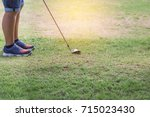 young  golfer with metal golf... | Shutterstock . vector #715023430
