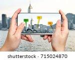 traveler hold mobile phone and... | Shutterstock . vector #715024870
