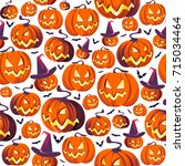seamless halloween pattern with ... | Shutterstock .eps vector #715034464