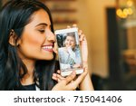 online dating  young indian... | Shutterstock . vector #715041406