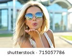 outdoor fashion portrait of... | Shutterstock . vector #715057786