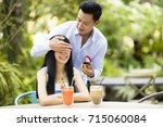 man proposing to girlfriend... | Shutterstock . vector #715060084