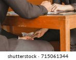 two businessmen are paying... | Shutterstock . vector #715061344