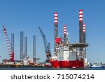 maintenance on a red and white... | Shutterstock . vector #715074214