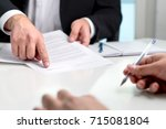 signing a contract or agreement.... | Shutterstock . vector #715081804