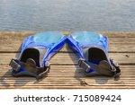 blue swim fins in the sunshine... | Shutterstock . vector #715089424