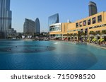 Small photo of Dubai Mall view from foot over bridge, Dubai Mall, Dubai, UAE, Middle East, 14th January 2017: Fantastic view of Dubai mall with blue water in the front side