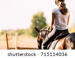 Stock photo picture of young pretty girl riding horse 715114036