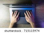 top view hands typing on laptop ...   Shutterstock . vector #715115974