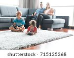 happy young family playing...   Shutterstock . vector #715125268
