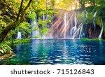 last sunlight lights up the... | Shutterstock . vector #715126843