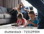 happy young family playing... | Shutterstock . vector #715129504