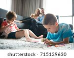 happy young family playing... | Shutterstock . vector #715129630