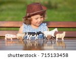 cute toddler girl playing with...   Shutterstock . vector #715133458