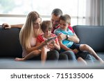 happy young family playing... | Shutterstock . vector #715135006