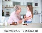 cute little girl and her... | Shutterstock . vector #715136110