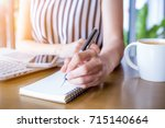 business woman hand working at...   Shutterstock . vector #715140664