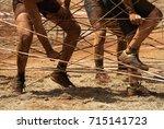 mud race runners racers...   Shutterstock . vector #715141723