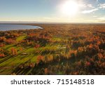 aerial view of the sun setting... | Shutterstock . vector #715148518