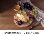 cheese board with grapes  figs... | Shutterstock . vector #715149208