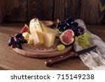 cheese board with grapes  figs... | Shutterstock . vector #715149238