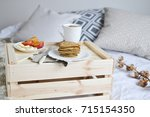 breakfast in bed cappuccino... | Shutterstock . vector #715154350