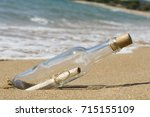 message in a bottle  close up | Shutterstock . vector #715155109